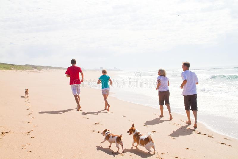 Download Family Running On Beach Stock Photos - Image: 13826963