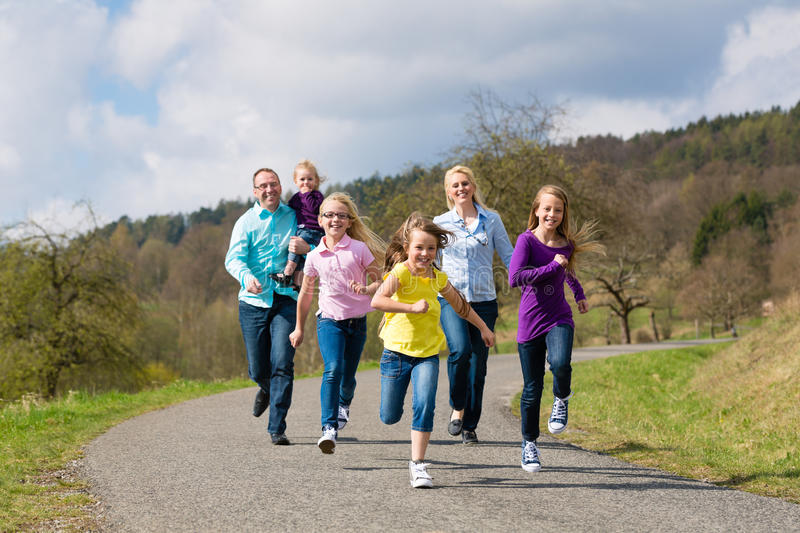 Family Is Running Outdoors Stock Images