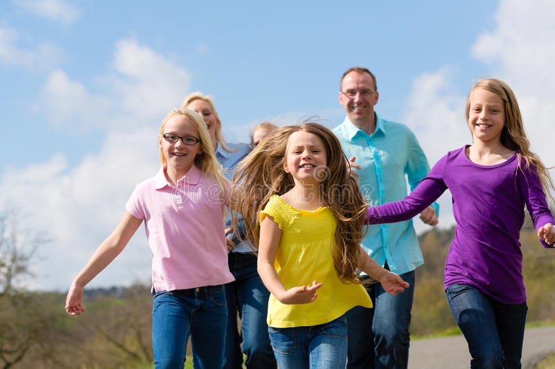 Family Is Running Outdoors Stock Image