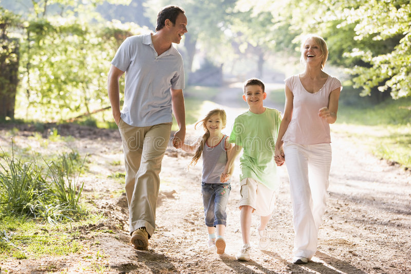 Download Family Running Outdoors Holding Hands And Smiling Stock Image - Image: 5770709