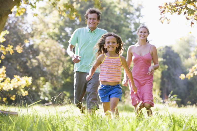 Family running outdoors smiling stock images