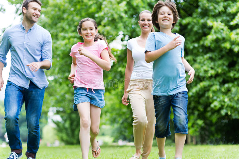 Family running in the park royalty free stock images