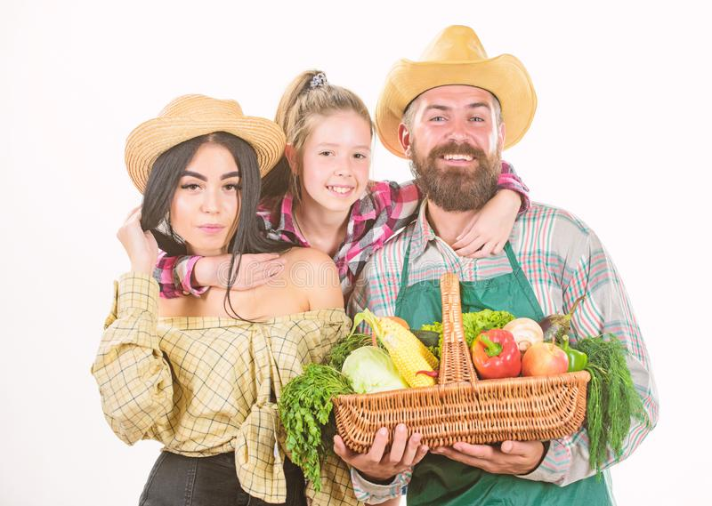 Family rustic farmers proud of fall harvest. Grown with love. Parents and daughter celebrate harvest. Harvest festival stock photos