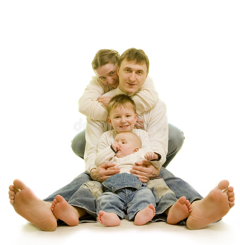 Family's heels. Attractive family on the floor barefoot stock photography