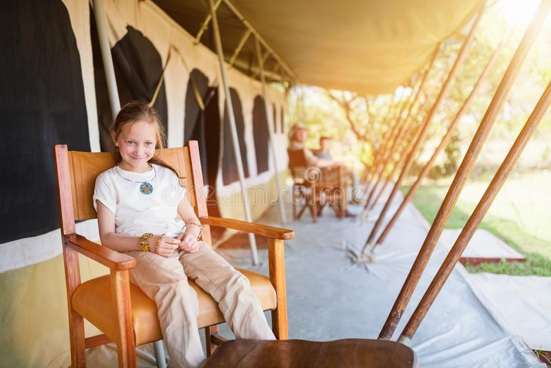 Family safari. Family in safari tent enjoying vacation in Africa royalty free stock image