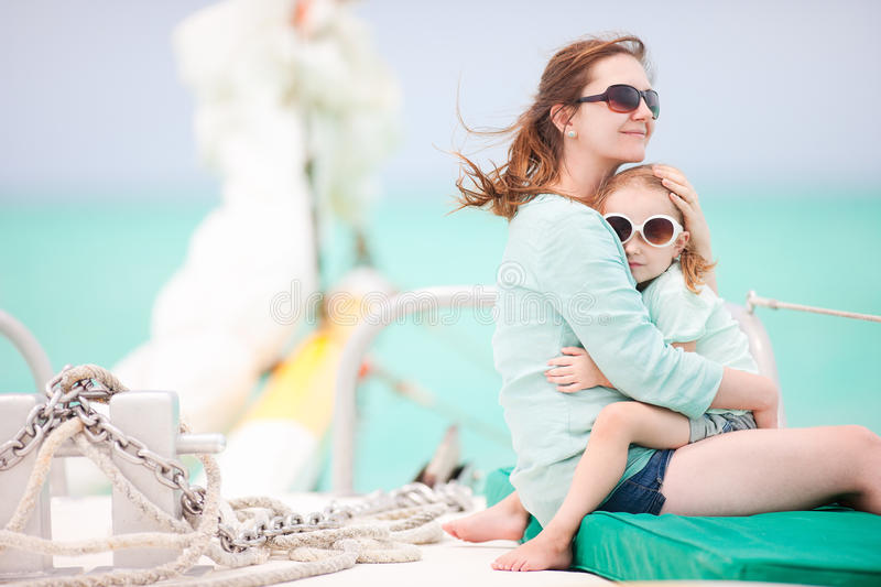 Family sailing on a luxury yacht. Mother and daughter sailing on a luxury yacht royalty free stock photo