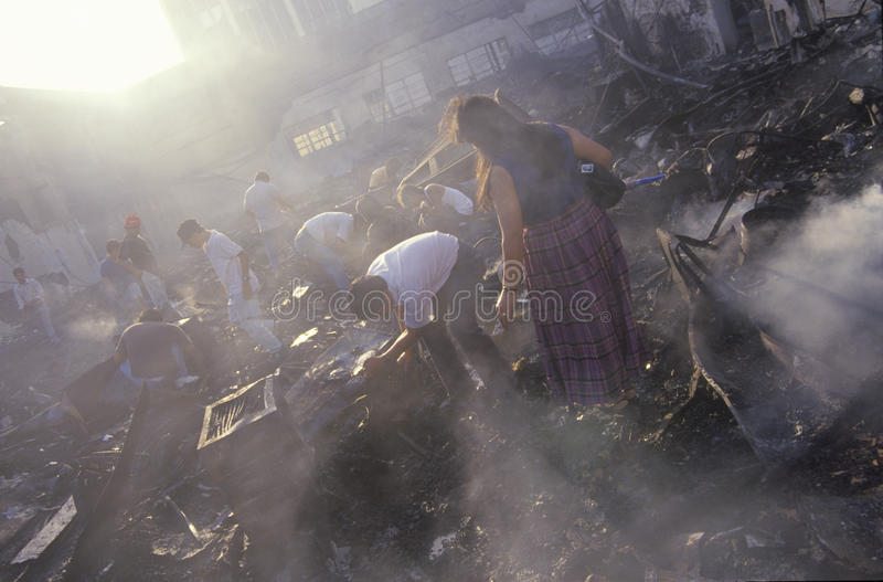 Download Family Salvaging Possessions After Riots, Editorial Stock Photo - Image: 26269458