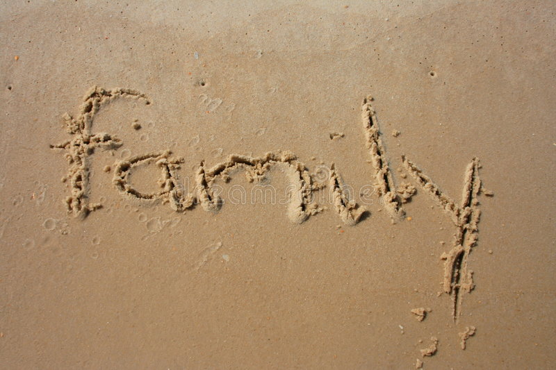 Family in the sand royalty free stock photography