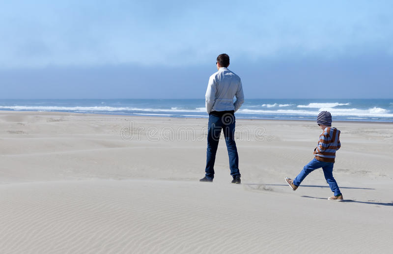 Family in sand dunes stock image
