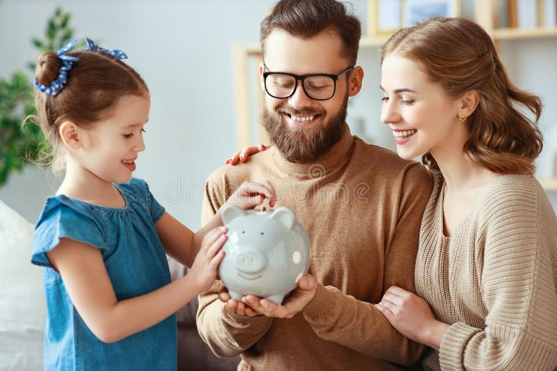 Family savings, budget planning, children`s pocket money. family with piggy Bank. Moneybox stock photo