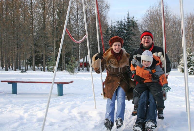 Family on seesaw stock photos