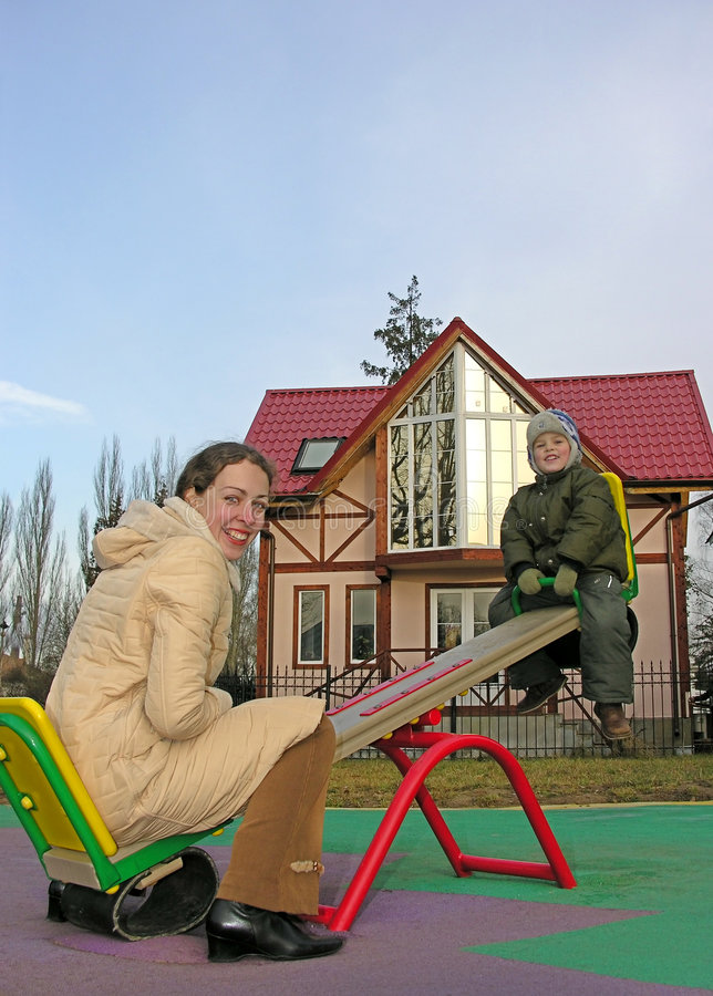 Download Family On Seesaw And Home Stock Photo - Image: 500620