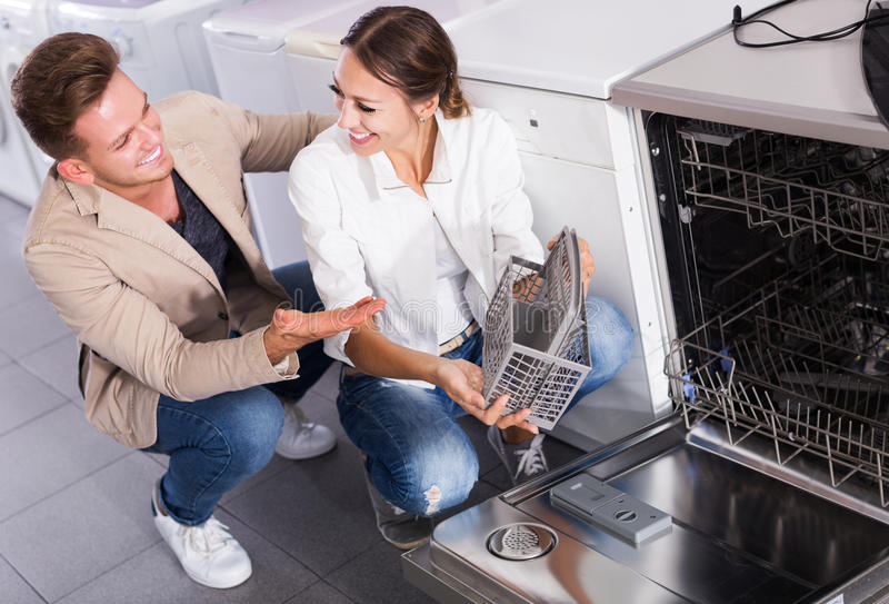 Family selecting modern dishwasher stock photo