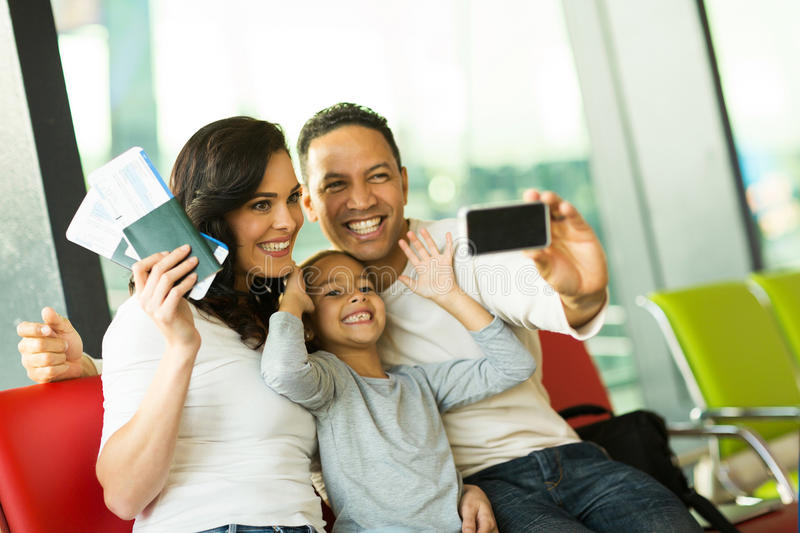 Family self portrait airport royalty free stock image