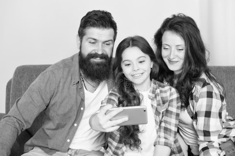 Family selfie. Family spend weekend together. Use smartphone for selfie. Friendly family having fun together. Mom dad stock photos
