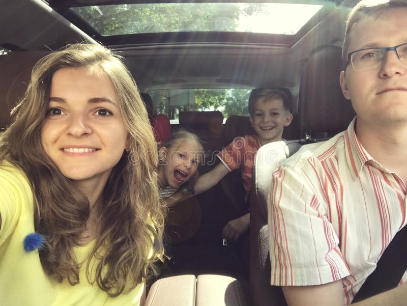 Family selfie photo in car on summer vacation. Family selfie photo in car during summer vacation royalty free stock photography