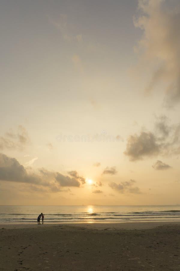 Family selfie under sunrise on beach royalty free stock photo