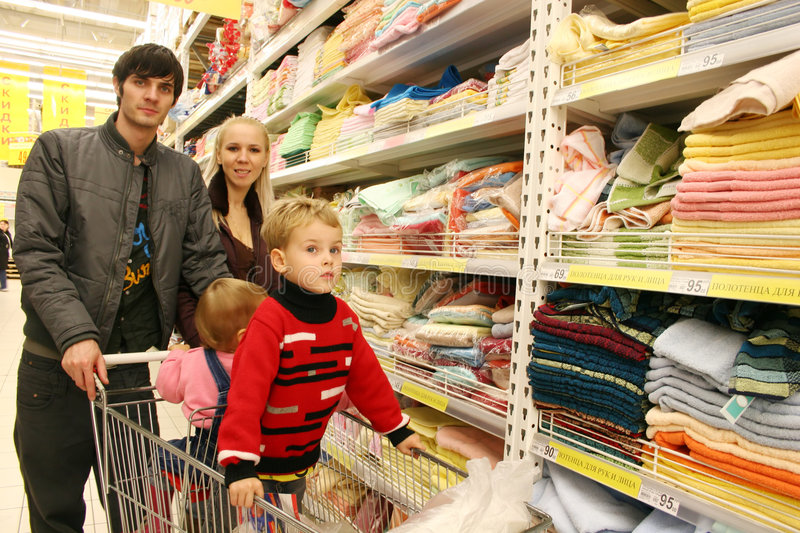 Family in shop. Family with two children in shop stock photography