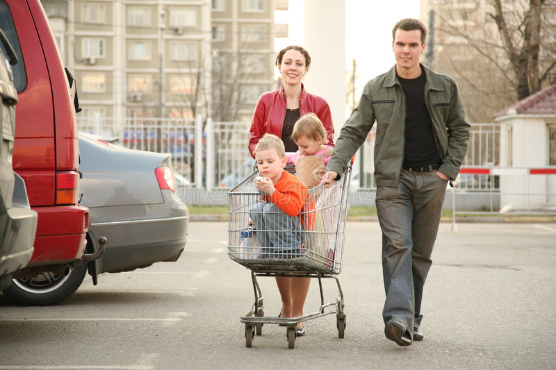 Family on shop parking. Family on the parking near the shop royalty free stock image