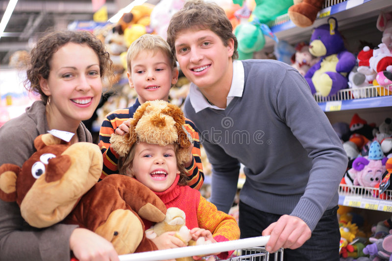 Family in shop with soft toys stock images