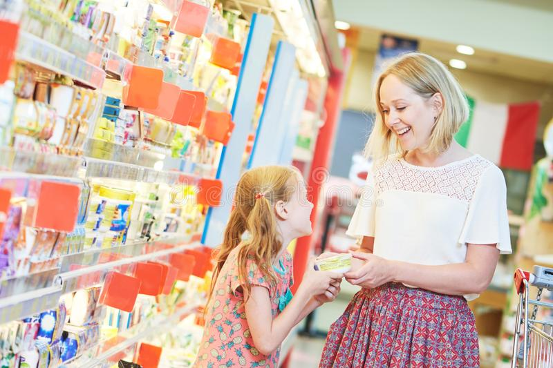 Family shopping dairy food in grocery store or supermarket stock photos