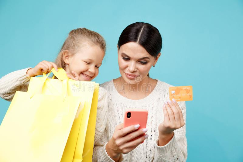 Family shopping online concept. Mother with daughter. Family shopping online concept. Mother with daughter stock image