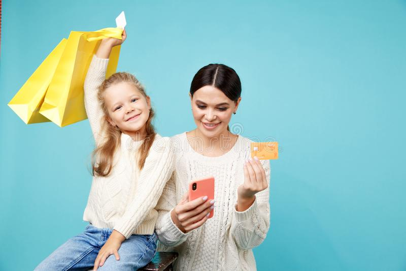 Family shopping online concept. Mother with daughter. Family shopping online concept. Mother with daughter royalty free stock images