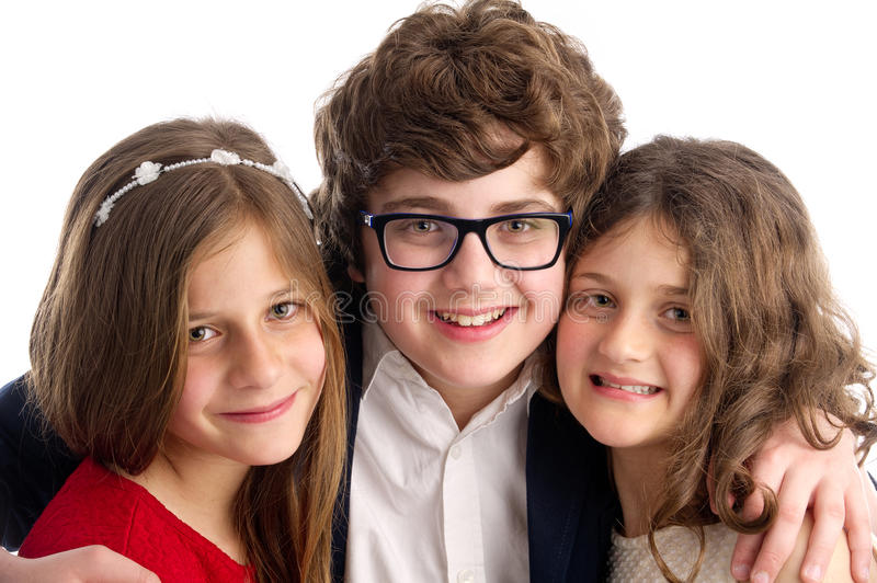 Family shot of a brother and two sisters isolated. On white background stock photography