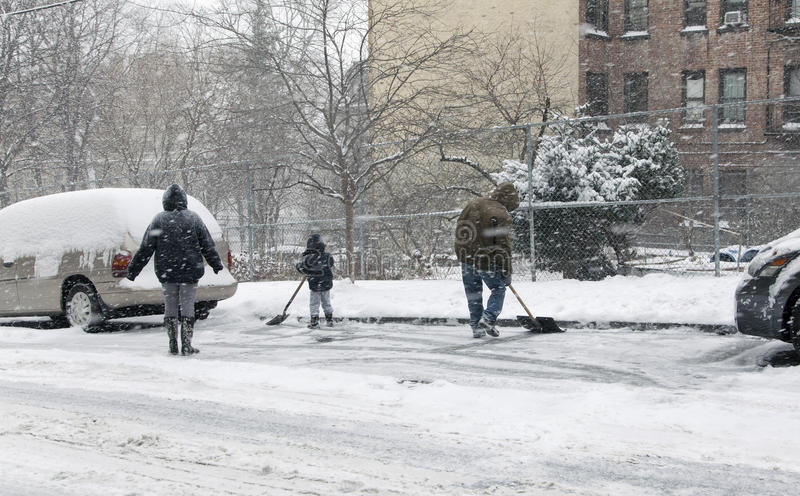 Download Family Shoveling During Snow Storm In New York Editorial Image - Image: 37609015