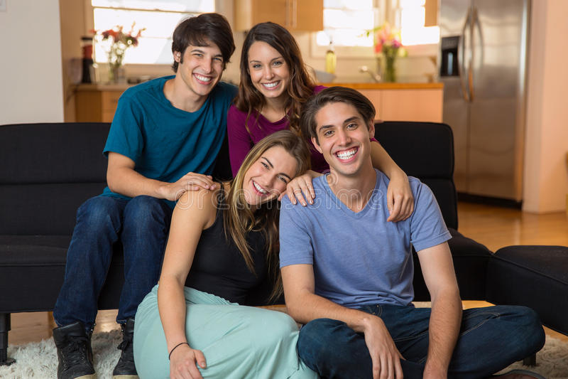 Family siblings at home smiling for a portrait love each other gathering reunion. Family siblings at home as friends and college buddies portrait of attractive stock photo