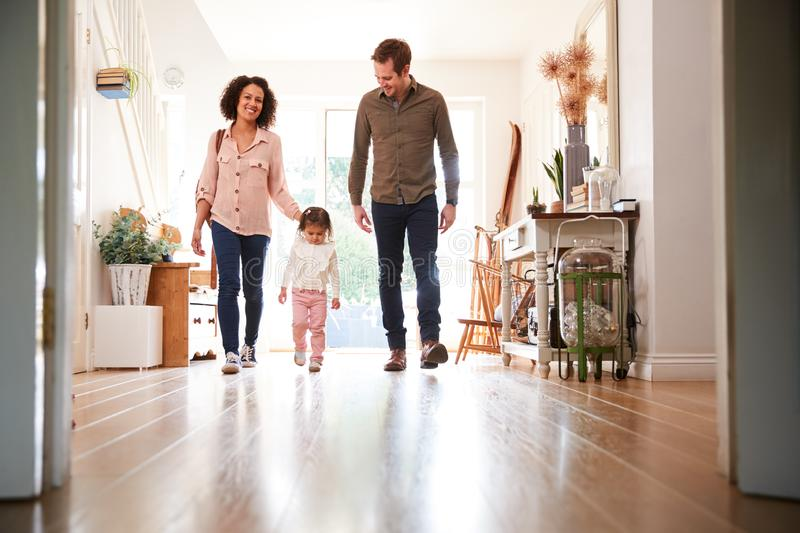 Family With Single Child Returning Home After Trip Out stock images