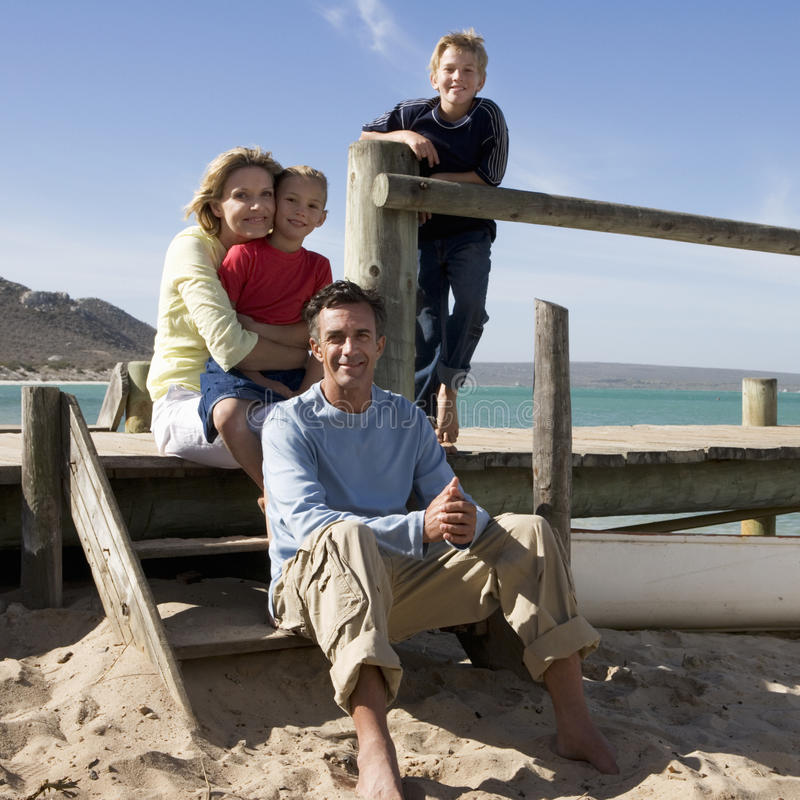 A family sitting on a beach royalty free stock images