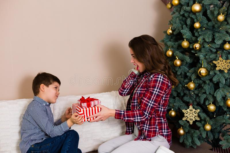 Family sitting by the Christmas tree royalty free stock photo