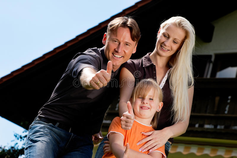 Download Family Sitting In Front Of Their Home Stock Photo - Image: 15360794
