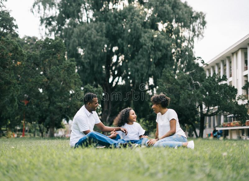 Family Sitting on Grass Near Building royalty free stock photo