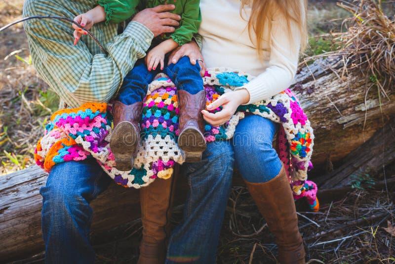 Family sitting outside on log stock images