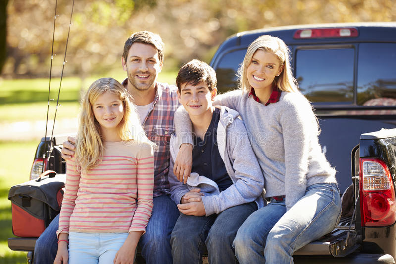 Family Sitting In Pick Up Truck On Camping Holiday royalty free stock photos