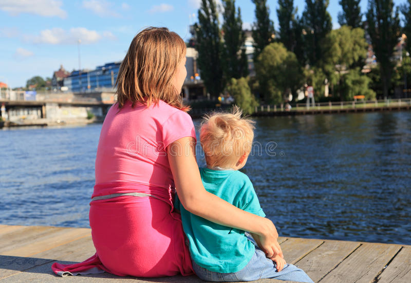 Download Family sitting on pier stock image. Image of pier, enjoyment - 26069239