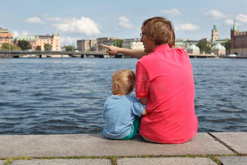 Family sitting on pier royalty free stock photos