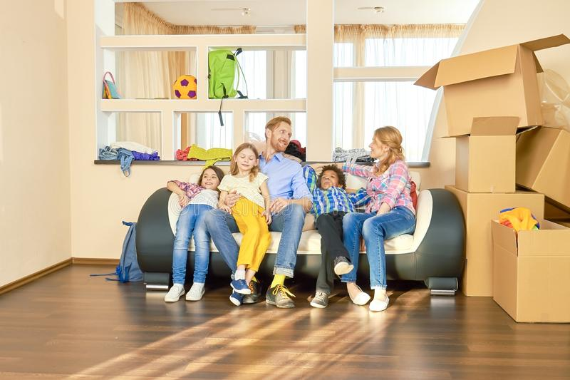 Family sitting on the sofa. stock images