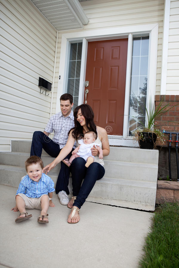 Family Sitting on Steps stock photos