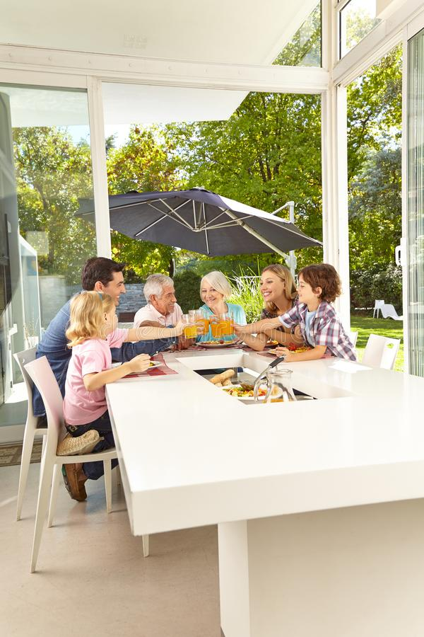 Family is sitting at the table having lunch royalty free stock photos