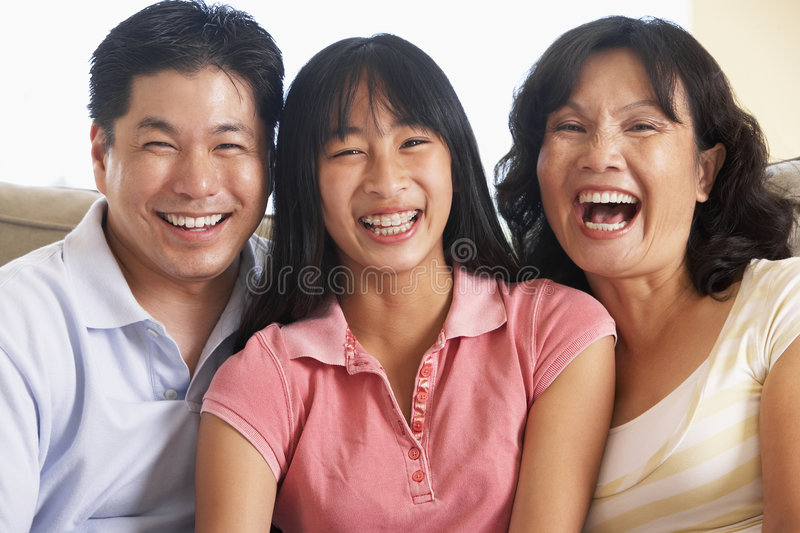 Download Family Sitting Together At Home Royalty Free Stock Image - Image: 8756586