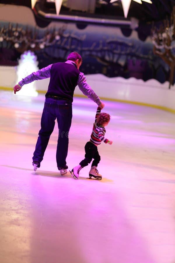 Family skating royalty free stock photos