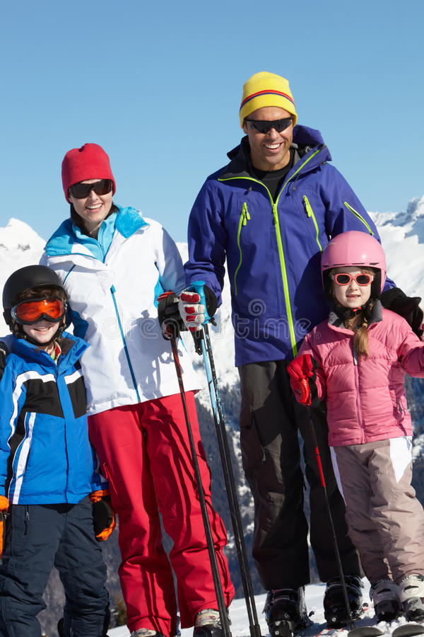 Family On Ski Holiday In Mountains Stock Photography