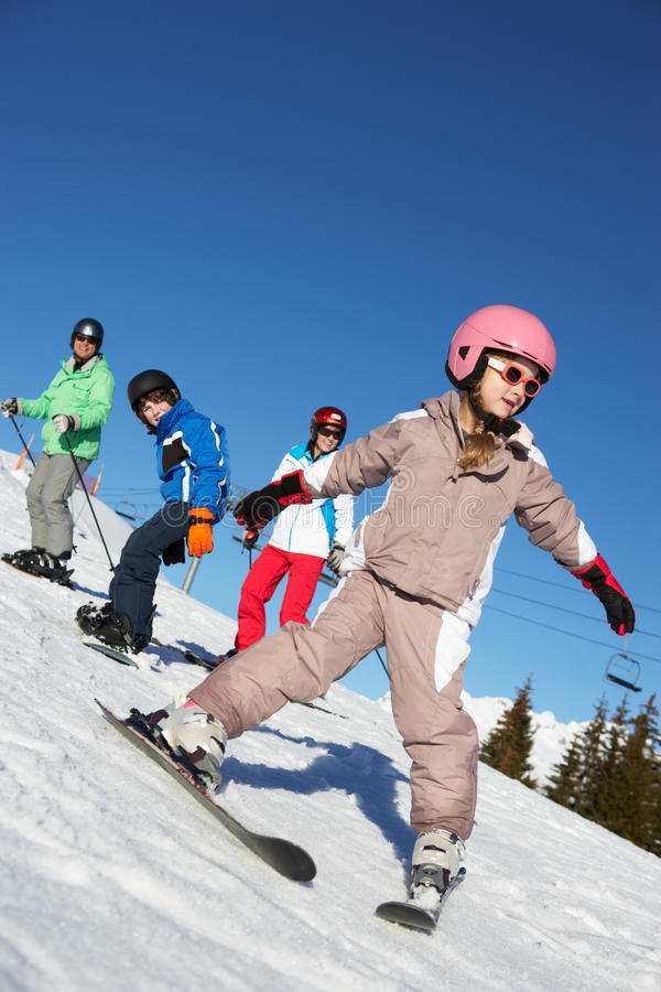 Family On Ski Holiday In Mountains royalty free stock image