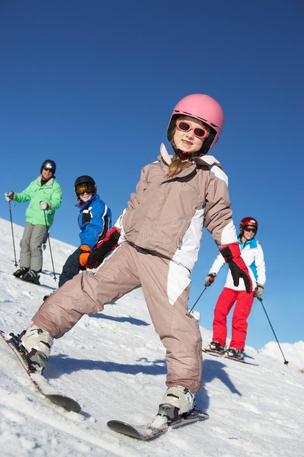 Family On Ski Holiday In Mountains stock photo