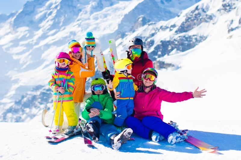 Ski and snow fun. Family in winter mountains. Family ski vacation. Group of skiers in Swiss Alps mountains. Adults and young children, teenager and baby skiing royalty free stock photos