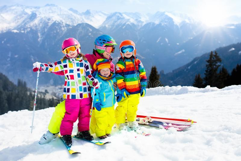 Family ski vacation. Winter snow sport for kids. Family ski vacation. Group of young skiers in the Alps mountains. Mother and children skiing in winter. Parents royalty free stock photo