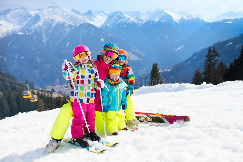 Family ski vacation. Winter snow sport for kids. Family ski vacation. Group of young skiers in the Alps mountains. Mother and children skiing in winter. Parents royalty free stock photography